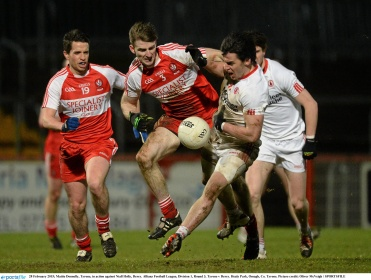 28 February 2015; Mattie Donnelly, Tyrone, in action against Niall Holly, Derry. Allianz Football League, Division 1, Round 3, Tyrone v Derry. Healy Park, Omagh, Co. Tyrone. Picture credit: Oliver McVeigh / SPORTSFILE